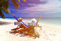 Happy couple relax on a tropical beach Stock Images