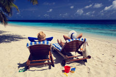 Happy couple relax on a tropical beach Royalty Free Stock Photo