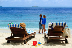 Happy couple relax on a tropical beach. Vacation Stock Images