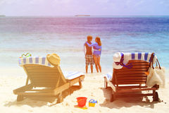 Happy couple relax on a tropical beach. Vacation Stock Photography