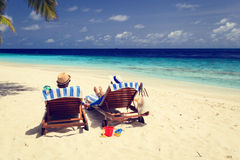 Happy couple relax on a tropical beach Stock Photography
