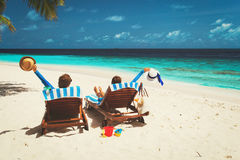 Happy couple relax on a tropical beach Royalty Free Stock Photography