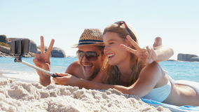 Happy couple relaxing on the beach. In ultra hd format stock footage