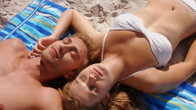 Happy couple relaxing on the beach. In ultra hd format stock video