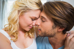 Happy couple relaxing on bed stock image