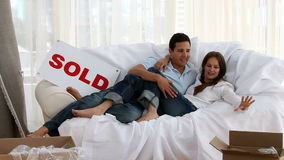 Happy couple relaxing on a bed stock video footage