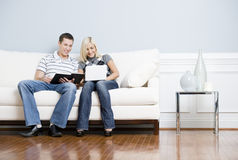 Happy Couple Relaxing on Couch Stock Photos