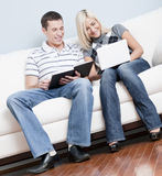 Happy Couple Relaxing on Couch Stock Images