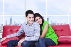 Happy couple relaxing on couch at home Royalty Free Stock Images