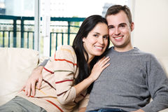 Happy couple relaxing at home Stock Photo
