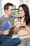 Happy couple relaxing at home Royalty Free Stock Photos
