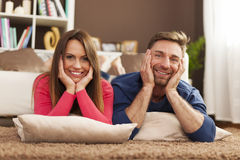 Happy couple relaxing at home Royalty Free Stock Image