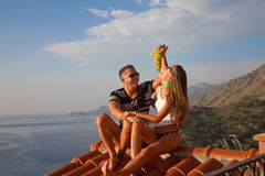 Happy couple relaxing on a hotel roof Royalty Free Stock Photo