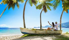 Happy Couple Relaxing on the Ocean. Seychelles island royalty free stock photography