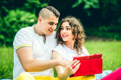 Happy couple relaxing outdoor in the green park Royalty Free Stock Photos