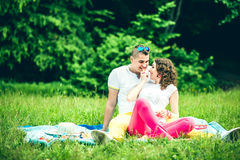Happy couple relaxing outdoor in the green park Royalty Free Stock Images