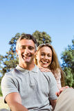 Happy couple relaxing in the park Stock Photography