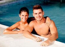 Happy couple relaxing in the pool Stock Photo