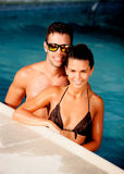 Happy couple relaxing in the pool. In the summer stock photo