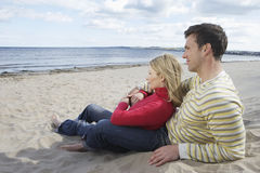 Happy Couple Relaxing On Sandy Beach Stock Images