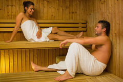 Happy couple relaxing in a sauna and chatting Royalty Free Stock Image