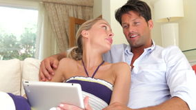 Happy couple relaxing on sofa  stock footage