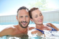 Happy couple relaxing in spa hot tub Royalty Free Stock Photography