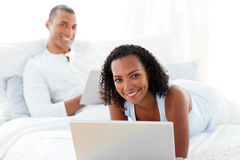 Happy couple relaxing on their bed Stock Image