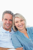 Happy couple relaxing on their couch Royalty Free Stock Photography