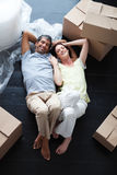 Happy couple relaxing in their new house Stock Photography