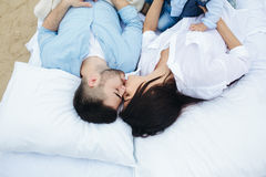 Happy Couple relaxing together on the mattress Royalty Free Stock Images