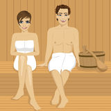 Happy couple relaxing together in wooden sauna Royalty Free Stock Photography