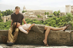 Happy Couple Relaxing On Wall Stock Images