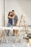 Happy couple renovating home Stock Photos