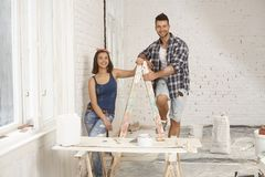 Happy couple at renovation site Royalty Free Stock Photography