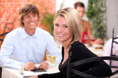 Happy couple at restaurant Royalty Free Stock Photos