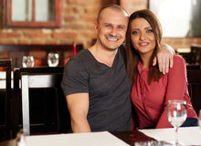Happy couple in a restaurant Stock Images