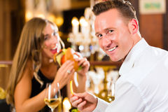 Happy couple in restaurant eat fast food Stock Images