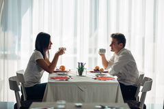 Happy couple at restaurant eating lunch.Talking over meal.Hotel full board,all inclusive stay.Travel, date,food,lifestyle. Smiling people having healthy Royalty Free Stock Image