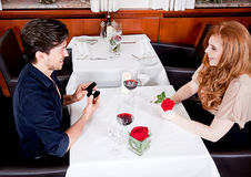 Happy couple in restaurant romantic date Stock Photos