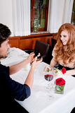 Happy couple in restaurant romantic date Royalty Free Stock Image