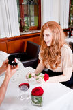 Happy couple in restaurant romantic date Stock Photography