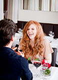 Happy couple in restaurant romantic date Stock Image