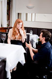 Happy couple in restaurant romantic date Stock Photo