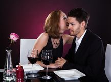 Happy couple in restaurant Royalty Free Stock Images