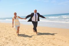 Happy couple resting on a  beach. Royalty Free Stock Image
