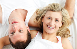 Happy couple resting in bed Royalty Free Stock Images