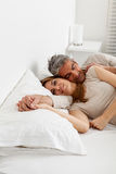 Happy couple resting in the bed Stock Photo