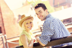 Happy couple resting on a bench Royalty Free Stock Photos