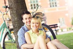 Happy couple resting in the park Stock Images